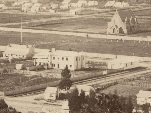 Detail from a late 1860s photograph showing the building from the rear (at centre). All Saints' Church is also prominent. Ref: Hocken Photographs Album 073.